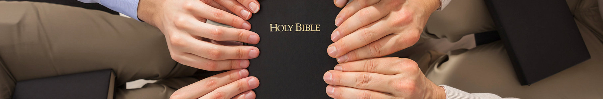 people holding the bible